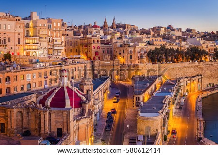 Valletta, Malta - The traditional houses and walls of Valletta, the capital city of Malta on an early summer morning before sunrise with clear blue sky Stock fotó ©