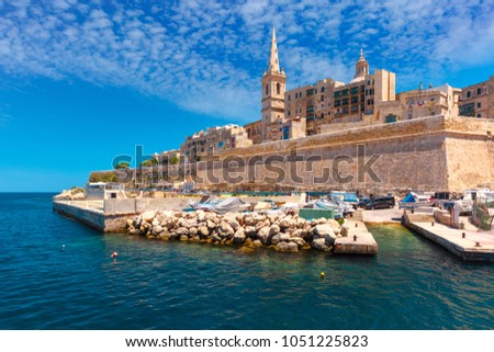 Valletta Skyline with fortress wall, boat pier and St. Paul's Anglican Pro-Cathedral, Valletta, Capital city of Malta. View from the sea Stock photo ©