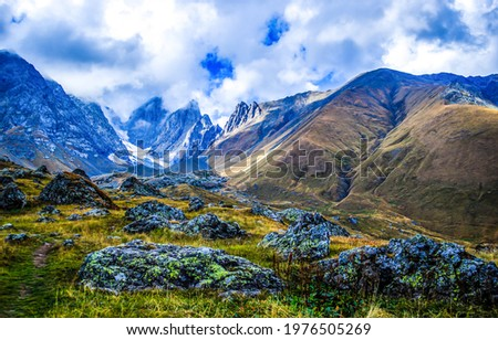 Valley among the mountain hills. Mountain valley landscape. Mountain valley in cloudy day
