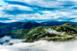 Valley fog and clouds above the mountains on an autumn morning, Point Mountain Overlook, Webster County, West Virginia, USA