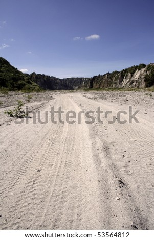 valley of ash and volcanic rock leading to mount pinatubo in the philippines