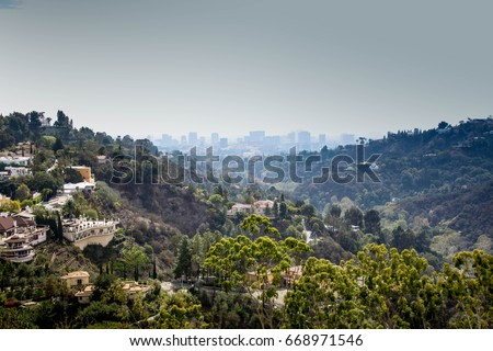 Valley of Bel Air luxury homes with building in the foggy background Сток-фото ©