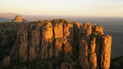 Valley of Desolation Rock Formations and hills during sunset near Graaff Reinet in South Africa.