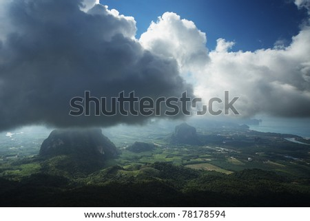 Valley of the Ao Nang town (Krabi province of Thailand) at sunny day with storm clouds in the sky.