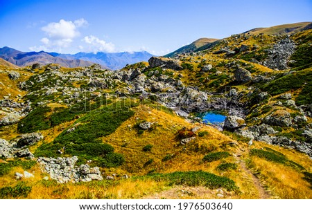 Valley of the hills in the mountains. Hill valley in mountains. Mountain hill valley landscape