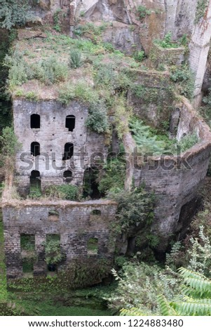 Valley of the mills (Valle dei Mulini), abandoned mills amidst undergrowth at the foot of a ravine in the centre of the old town of Sorrento on the Amalfi Coast, Italy. #1224883480
