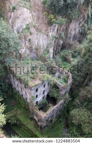 Valley of the mills (Valle dei Mulini), abandoned mills amidst undergrowth at the foot of a ravine in the centre of the old town of Sorrento on the Amalfi Coast, Italy. #1224883504