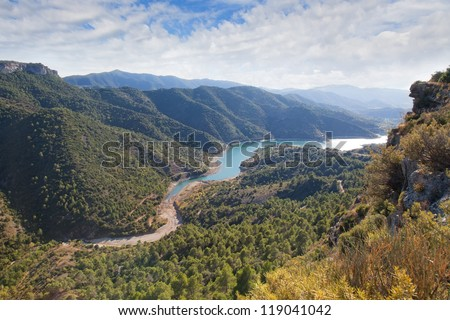 Valley with the river and cloudy sky in the Catalonian mountains