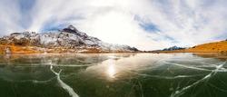 Valmalenco (IT) - Frozen lake with Pizzo Scalino on the bottom