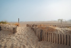 Valras-Plage sandy beach south of France with wooden febce