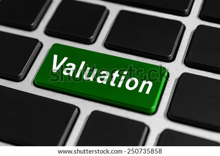 valuation green button on keyboard, business concept