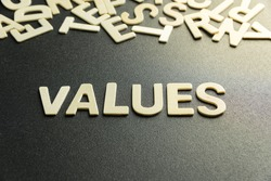 VALUE word made with wooden letter