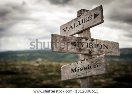 Values, vision, mission vintage wooden signpost in nature. Moody, signpost, board, quote, message, business, corporate concept. #1312808615
