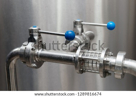 Valves and fittings on beer making equipment, food processing plant