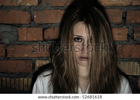 Vampire girl in front of grunge wall