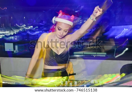 Stock Photo Vampire Lady dj .Halloween Woman portrait. Beauty Sexy Vampire Girl.Vampire makeup Fashion Art design,Blur Lady Dj in club party,slow sync flash technique is feeling movement.