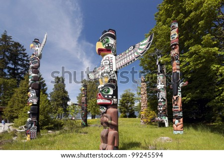 VANCOUVER, B.C. - MAY 22: Totem Poles in Stanley Park, the recurring symbols of the area indigenous population, are popular Vancouver's attraction. May 22, 2007 in Vancouver, British Columbia.