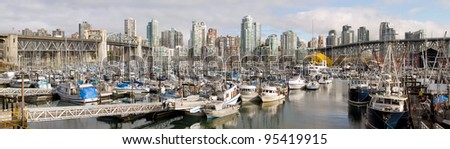 Vancouver BC Canada City Skyline with Burrard and Granville Bridges from Granville Island Panorama
