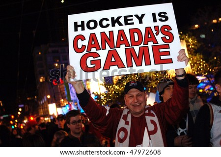 VANCOUVER, BC, CANADA - FEBRUARY 28: Canadian man celebrates Canada Hockey Team Gold Medal win at 2010 Winter Games, February 28, 2010 in Vancouver, BC, Canada