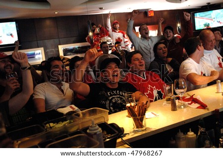 VANCOUVER, BC, CANADA - FEBRUARY 28: Canadians are watching Gold Medal hockey game between Team Canada and Team USA during 2010 Winter Games, February 28, 2010 in Vancouver, BC, Canada
