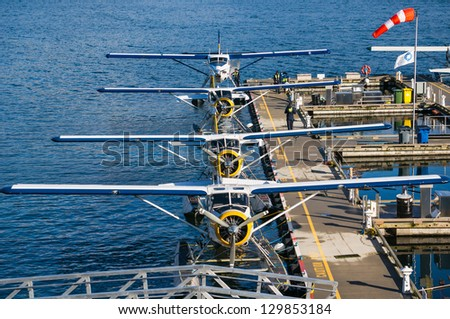 VANCOUVER, BC, CANADA, FEBRUARY 23: Row of seaplanes and unidentified maintenance personnel at the Vancouver Harbour Flight Centre in Vancouver on February 23, 2013.