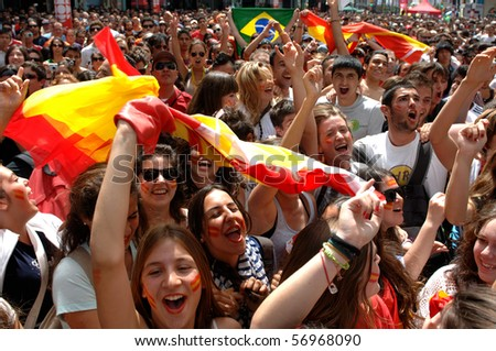 VANCOUVER, BC, CANADA - JULY 11: Spanish fans celebrate Spain soccer team FIFA Soccer World Cup final game victory over Dutch soccer team on Granville Street, July 11, 2010 in Vancouver, BC, Canada