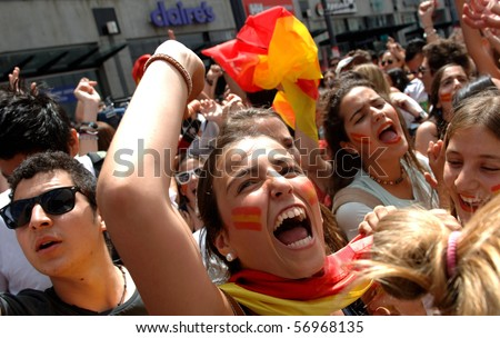 VANCOUVER, BC, CANADA - JULY 11: Spanish fans celebrate Spain soccer team FIFA Soccer World Cup final game victory over Dutch soccer team on Granville Street, July 11, 2010 in Vancouver, BC, Canada - Shutterstock ID 56968135