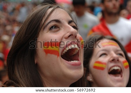 VANCOUVER, BC, CANADA - JULY 11: Spanish fans celebrate Spain soccer team FIFA World Cup final game victory over Dutch soccer team on Granville Street, July 11, 2010 in Vancouver, BC, Canada