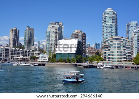 VANCOUVER BC CANADA JUNE 27 2015: Downtown Vancouver in the north-central part of the City of Vancouver. It is the business, commercial, cultural, financial, government, and entertainment centre