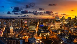Vancouver, British Columbia, Canada. Aerial Panoramic View of Modern Downtown City during Twilight. Dramatic Colorful Sunset Sky Composite.