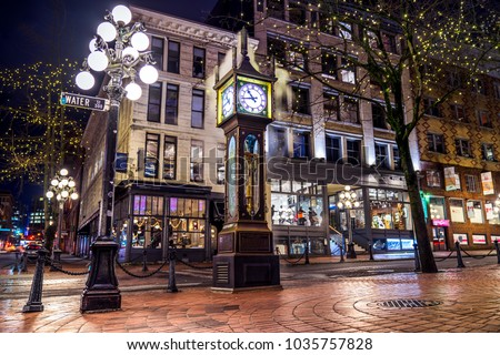 Vancouver, British Columbia - Canada. Downtown iconic landmark on a chilly night just after a rain, the Steam Clock, Gastown- Vancouver, British Columbia, Canada.