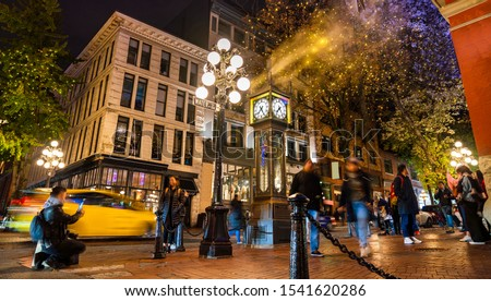 Vancouver, British Columbia - Canada. Downtown iconic landmark on a chilly night just after a rain, the Steam Clock, Gastown - Vancouver, British Columbia, Canada. #1541620286