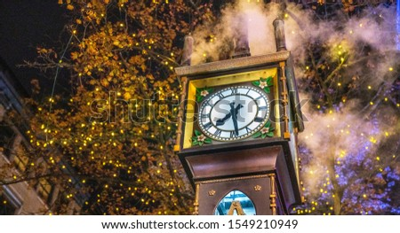 Vancouver, British Columbia - Canada. Downtown iconic landmark on a chilly night just after a rain, the Steam Clock, Gastown- Vancouver, British Columbia, Canada. #1549210949