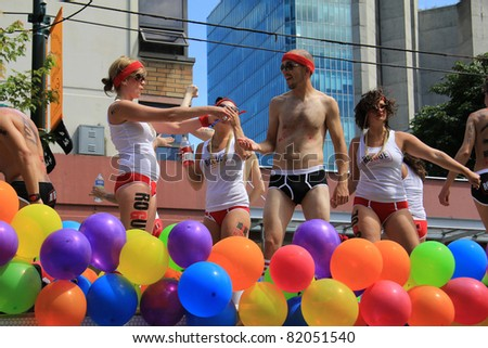 VANCOUVER BRITISH COLUMBIA, CANADA - JULY 31: Colorfully dressed participants during the annual gay pride parade on July 31 2011 in Vancouver, B.C. Canada. - stock photo
