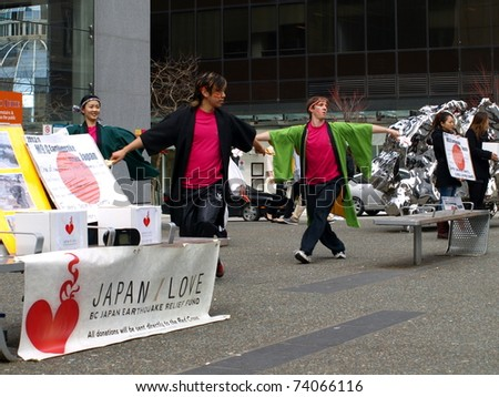 VANCOUVER, BRITISH COLUMBIA - MARCH 27: Japanese demonstration and fundraising to help victims after the earthquake in downtown Vancouver on March 27, 2011 2 p.m.