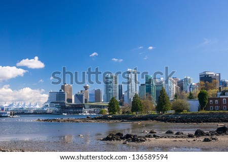 VANCOUVER, CANADA - APRIL 14, 2013: View on Downtown Vancouver from Stanley Park on April 14, 2013. Downtown Vancouver is business, cultural, commercial and entertainment center of the city.