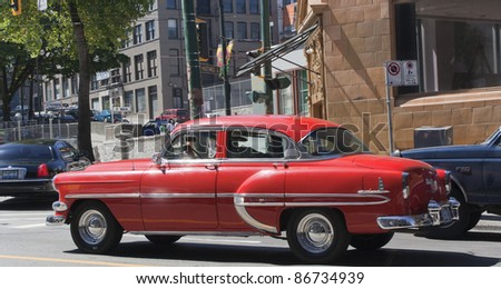 VANCOUVER, CANADA - AUGUST 06: Chevrolet Bel Air driving through downtown Vancouver, Canada on August 05, 2005. This vintage car was produced by the Chevrolet division of General Motors.