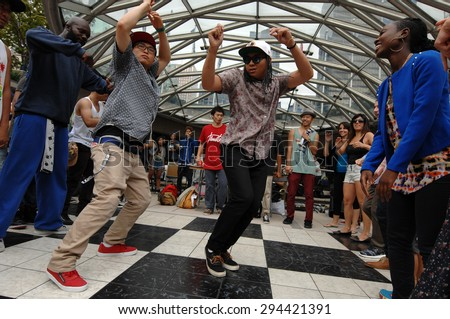 VANCOUVER, CANADA - AUGUST 4, 2012: Dancers take part in the public Street Dance Festival at Robson Square in Vancouver, Canada, August 4, 2012.