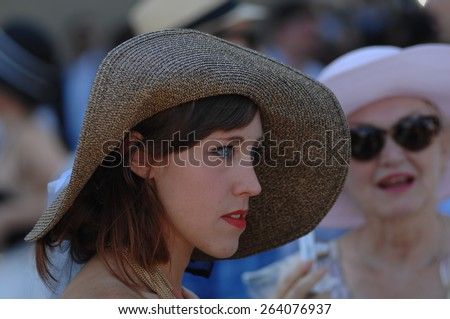 VANCOUVER, CANADA - JULY 26, 2014: A woman attends horse-racing derby in Vancouver, Canada, on July 26, 2014.