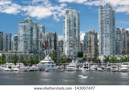 VANCOUVER, CANADA - June 13, 2013: People enjoy sunny day in Yaletown on June 13, 2013. Formerly a warehouse district, Yaletown is one of the most densely populated neighborhoods in the city.