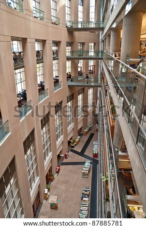VANCOUVER, CANADA - MAY 12: Interior of the Vancouver Public Library on May 12, 2007 in Vancouver, Canada. The library is 3rd largest public library system in Canada, with more than 2.5 million items in its collections. - stock photo