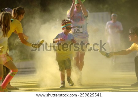 VANCOUVER, CANADA - SEPTEMBER 13, 2014: Thousands of runners took part in The Color Run 2014, known as the happiest 5km on the planet, in Vancouver, Canada, on September 13, 2014. #259825541