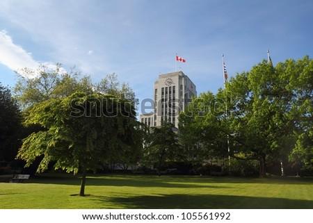 Vancouver City Hall, British Columbia. The Vancouver City Hall building and surrounding lawn and trees. Vancouver, British Columbia, Canada.