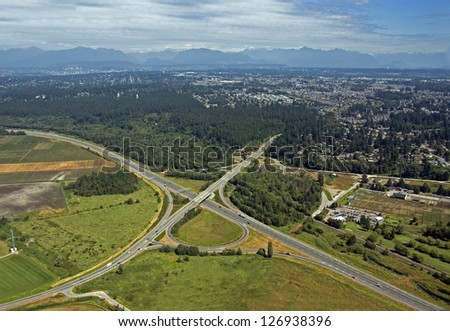 Vancouver - Highway with bridge by the fields and forest
