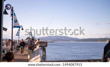 Vancouver Island, Canada - August, 30th, 2017: view of the pier of city of Camber River during a summer sunny day with boats and fishermen  #1494087953