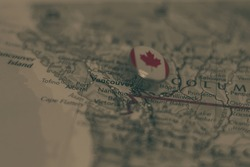 Vancouver pinned on a map with the flag of Canada