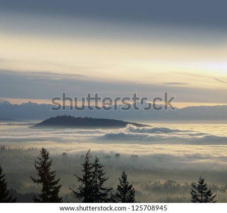 Vancouver, SFU, Burnaby Mountains, Richmond and Vancouver Island Mountains in the clouds