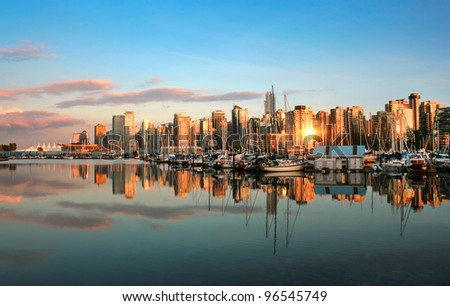 Vancouver skyline at sunset as seen from Stanley Park, British Columbia, Canada