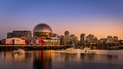 Vancouver Skyline at Sunset at the Eastern Shore of False Creek Inlet with the Science Center Globe in British Columbia, Canada