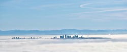 Vancouver skyline swallowed by fog in winter morning. View from Cypress Mountain. Cypress Mountain Provincial Park. North Vancouver. British Columbia. Canada.